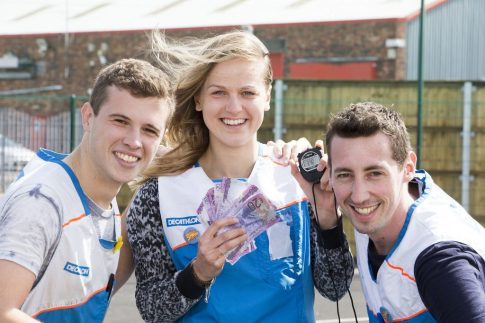 Race wager - Stuart Terris, left and Amaury Wicquart with colleague, Bertille Mazure holding the money and the stopwatch